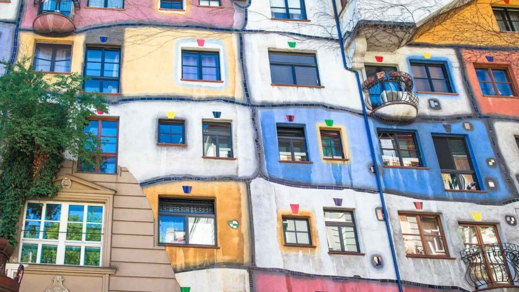 Beautiful colorful Hundertwasser house with a garden upstairs in Vienna, Austria
